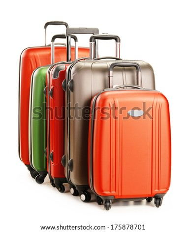 Luggage consisting of large suitcases isolated on white - stock photo