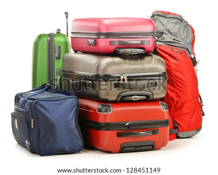 Luggage consisting of large suitcases rucksack and travel bag isolated on white - stock photo
