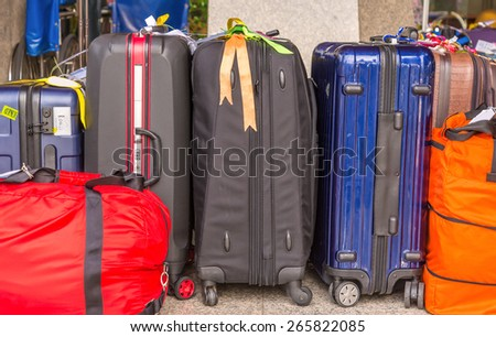 Luggage consisting of large suitcases rucksacks and travel bag - stock photo