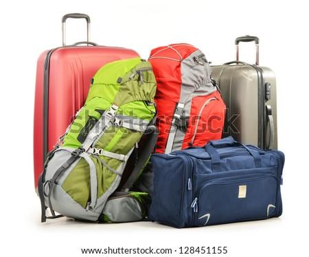 Luggage consisting of large suitcases rucksacks and travel bag isolated on white - stock photo