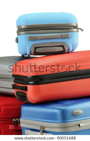 Luggage consisting of polycarbonate suitcases isolated on white - stock photo