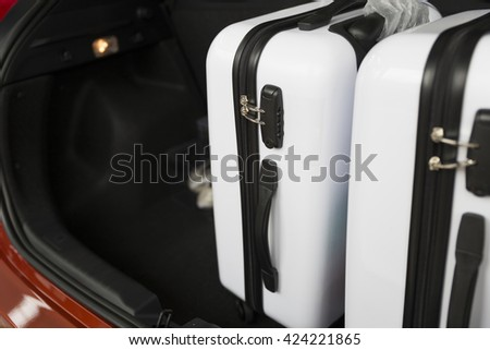 luggage in car trunk for traveling and vacation concept
