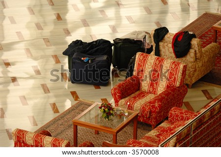 Luggage in hotel lobby - stock photo