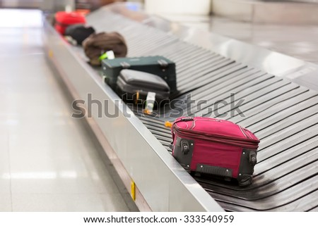 Luggage on the belt in the airport - stock photo