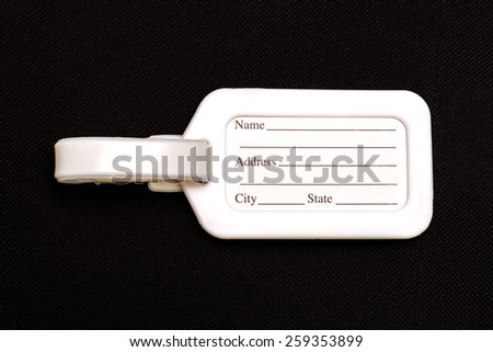 Luggage Tags Isolated on the fabric background. - stock photo