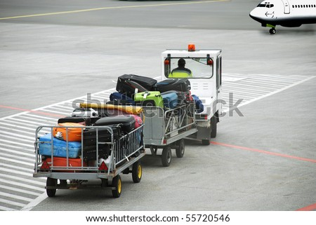 Luggage traffic on an electromobile  to the plane - stock photo