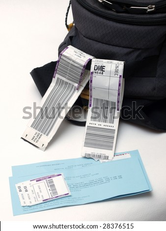 luggage with barcode label on white background - stock photo