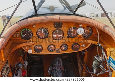 LUGO, RA, ITALY - JUNE 7: instrument panel of Boredom Fighter aircraft. Cockpit and dashboard of a retro-styled plane, at festival Belle Epoque of Aero Club Lugo on June 7, 2014 in Lugo, RA, Italy    - stock photo
