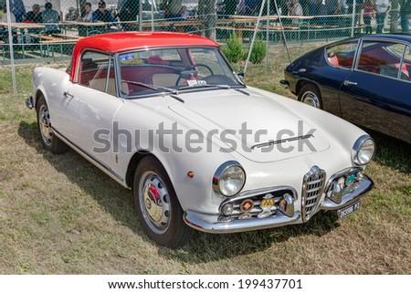 "LUGO, RA, ITALY - JUNE 7: vintage italian car Alfa Romeo Giulietta Spider 1600 (1964) exposed at festival ""Belle Epoque"" of Aero Club Lugo on June 7, 2014 in Lugo, RA, Italy    - stock photo"