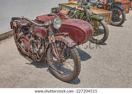 "LUGO, RA, ITALY - JUNE 7: vintage sidecar motorcycle Indian Scout Side 600 cc (1923) exposed at festival ""Belle Epoque"" of Aero Club Lugo on June 7, 2014 in Lugo, RA, Italy"