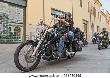 """LUGO, RA, ITALY - SEPTEMBER 22: bikers riding motorbike Harley Davidson during the motorcycle rally """"Sangiovese tour"""" by Ravenna Chapter on September 22, 2013 in Lugo, RA, Italy - stock photo"""