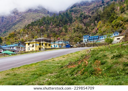 LUKLA, KHUMBU REGION, NEPAL CIRCA APRIL 2013  The short, steeply sloping runway of Tenzing Hillary Airport circa 2013, is considered one of the most dangerous in the world, Lukla, Nepal - stock photo