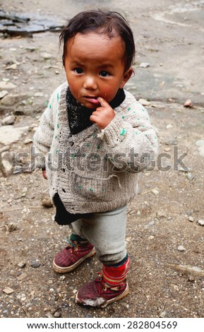 LUKLA, NEPAL -SEPTEMBER 30: Unidentified sherpa boy on September 30, 2007 in Lukla, Everest Region, Nepal. Sherpa are an ethnic group from Nepal, highly regarded as elite mountaineers