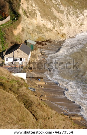 Lulworth Cove, Dorset - view from the clifftop on a stormy day, when the tide is very high. - stock photo