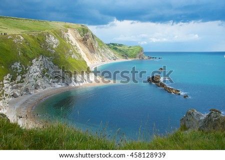 Lulworth, England, July 13, 2016 - Man O' War Bay at Durdle Dor, part of the Jurassic Coast World Heritage Site near Lulworth Cove