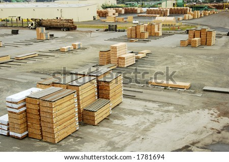 Lumber being moved at a forest products processing plant. - stock photo