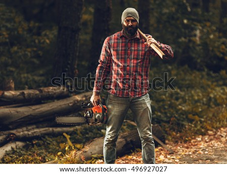 lumberjack worker standing forest axe chainsaw stock photo