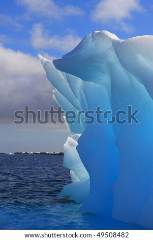 Luminescent iceberg in Antarctica with lovely blue colors. - stock photo
