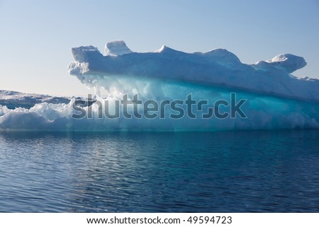 Luminescent iceberg in Greenland - stock photo