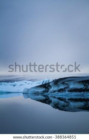 Luminous blue icebergs floating in Jokulsarlon glacial lagoon, Iceland - stock photo