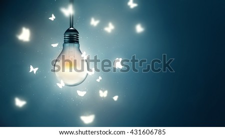 luminous bulb and butterflies flying on light