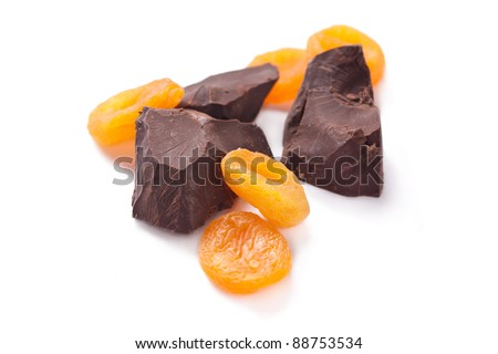 Lump chocolate and dried apricots - stock photo