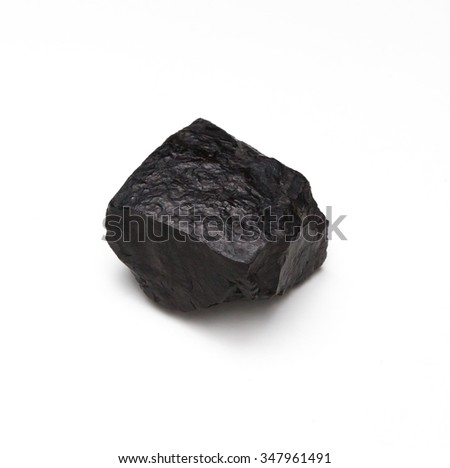 Lump of coal isolated on a white background - stock photo
