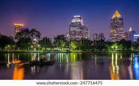 Lumphini park Bangkok downtown city at night, Thailand - stock photo