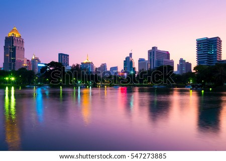 Lumpini park and city skyline in Bangkok, Thailand.