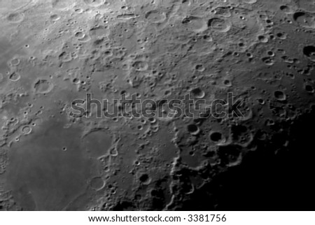 Lunar craters in a telescope image.