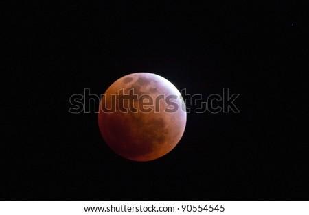 lunar eclipse as seen from Samui,Thailand December 10,2011 - stock photo
