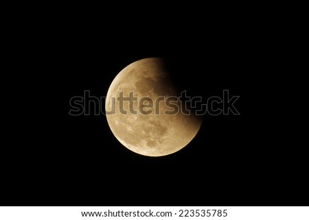 Lunar eclipse in the dark sky, shot from Chaing Mai, thailand - stock photo