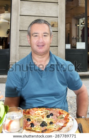 Lunch at an Italian restaurant in the city - stock photo