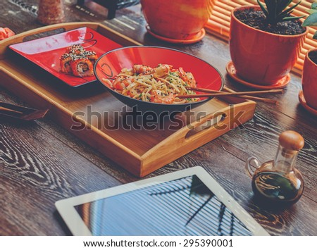 Lunch at the office, Japanese sushi and noodles to order from the fish restaurant, sticks, soy sauce in a set - stock photo