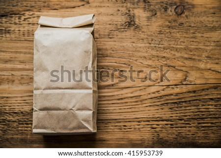 Lunch bag isolated on wooden texture background ot kitchen table.  - stock photo