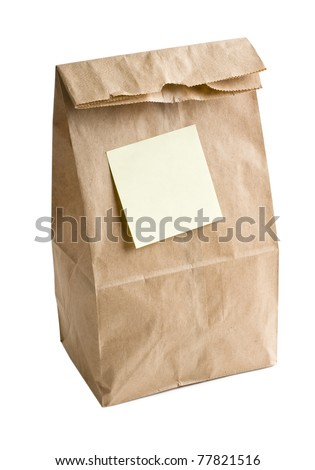 Lunch bag with empty post note on it. - stock photo