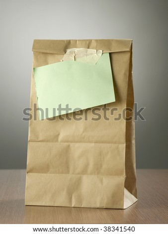 lunch bag with note on it - stock photo