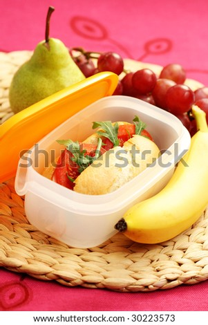 lunch box with delicious bun - food and drink - stock photo