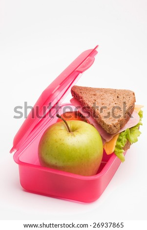 lunch box with ham and cheese sandwich and apple - stock photo