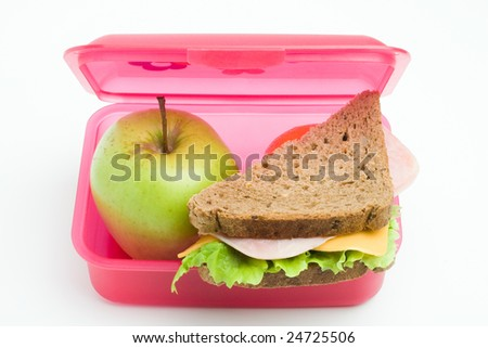 lunch box with sandwich and apple - stock photo