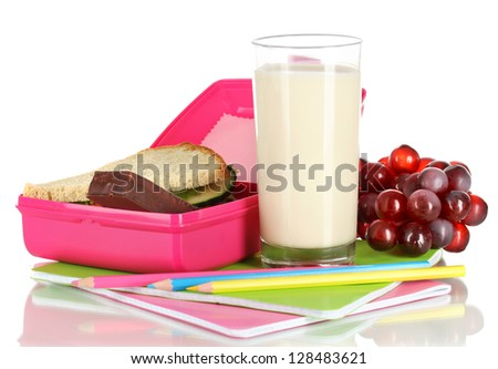 Lunch box with sandwich,milk,grapes and stationery isolated on white - stock photo