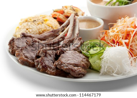 Lunch - Cabbage Salad, Miso Soup, Fried Vegetable, Sliced Cucumber, Roasted Lamb Chops, Rice and Sauce - stock photo