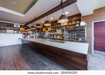 Lunch counter at modern public catering restaurant - stock photo