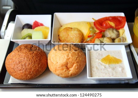 lunch in airplane - seafood meal - stock photo