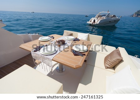 lunch on motor boat, Table setting at a luxury boat. - stock photo