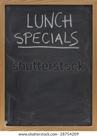 lunch specials title handwritten with white chalk on blackboard, copy space below, restaurant advertisement - stock photo