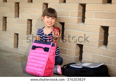 Lunch time for elementary student - stock photo