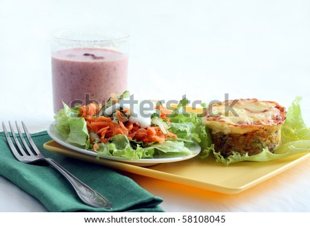 Lunch with salad and tuna vegetable  casserole - stock photo