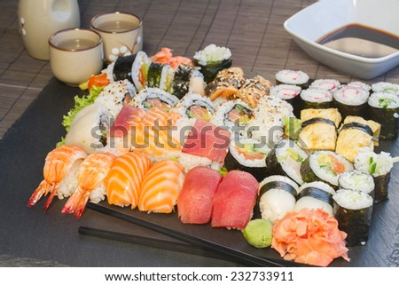 lunch with set of  japaneese  nigiri and rolls sushi dish on black background