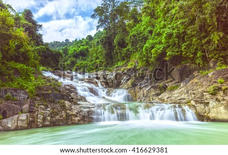 Lunch Yangbay panoramic rapids spring with cascade flowing down the valley from the forest into the lake overflows rùi great natural beauty to create mountains of Khanh Hoa, Vietnam - stock photo